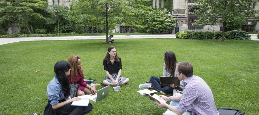students sitting out on the University of Chicago Quad